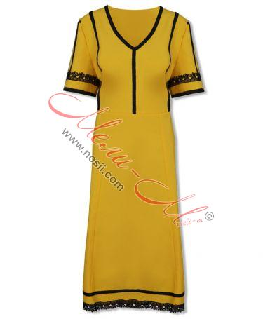 Traditional  Women's pinafore (sukman)  richly decorated with braids